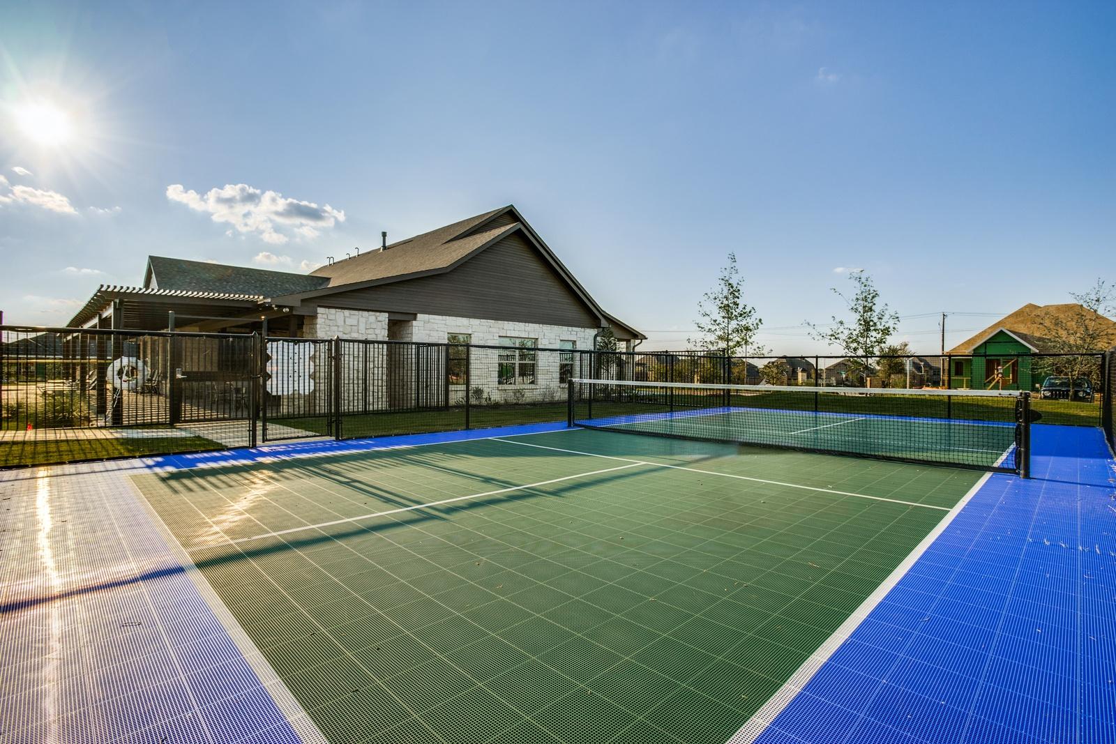 a-large-tennis-court-with-interlocking-green-flooring