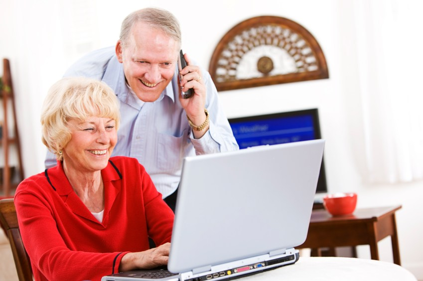 Senior Happy Couple Using Laptop