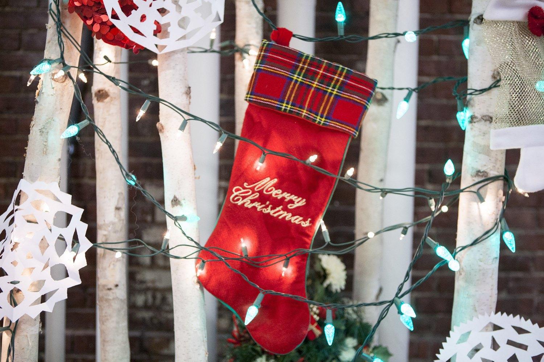 red-christmas-stocking-hanging-on-christmas-lights