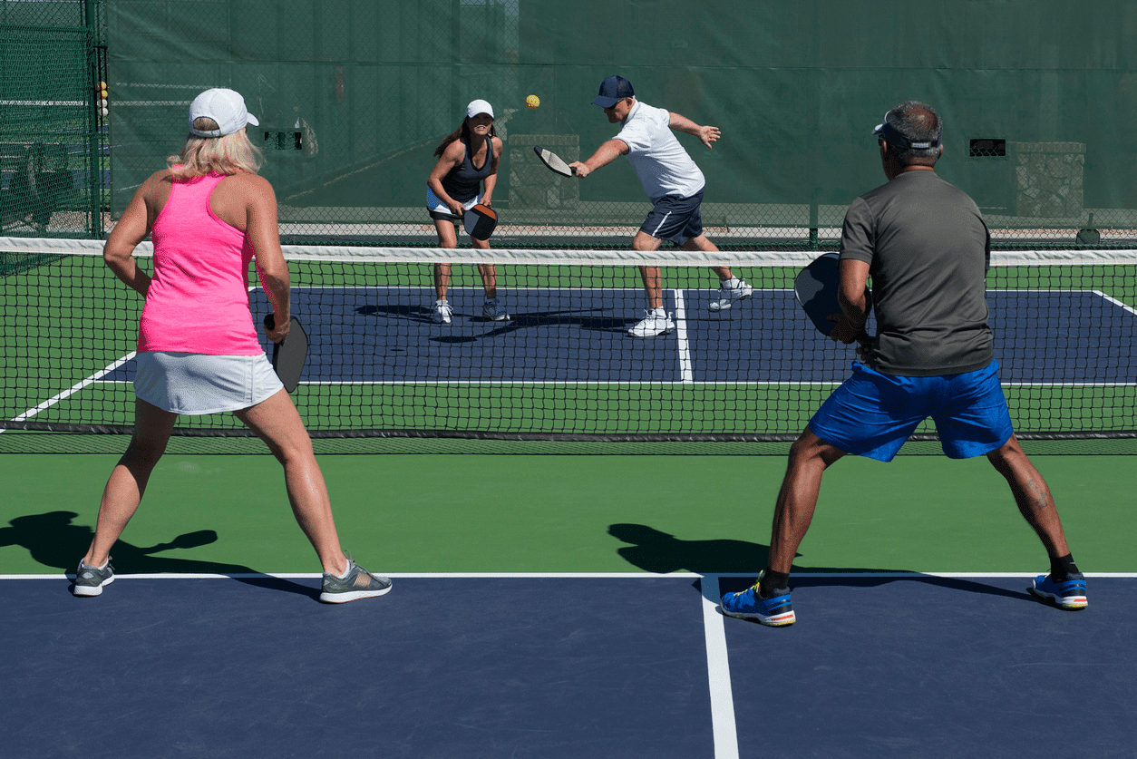 two-active-adults-intensively-playing-pickleball-in-the-middle-of-the-sun