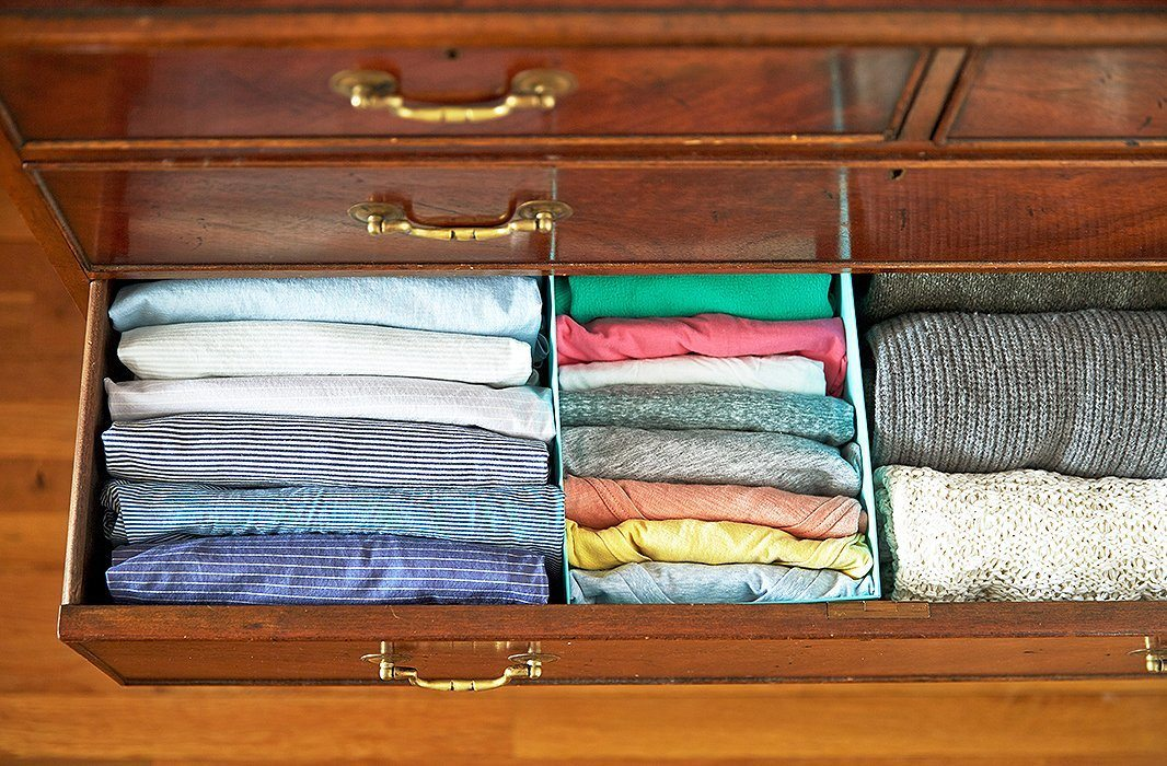a-large-closet-drawer-with-organized-nice-and-neat-folded-shirts