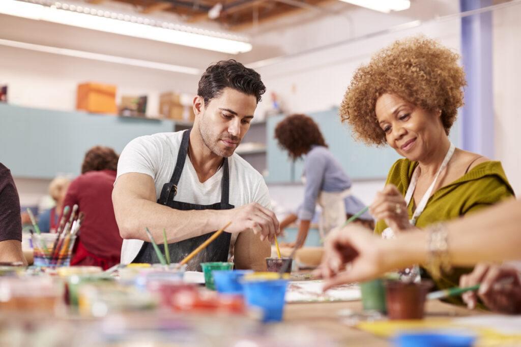 group of mature adults attending art class in comm s4b25vm