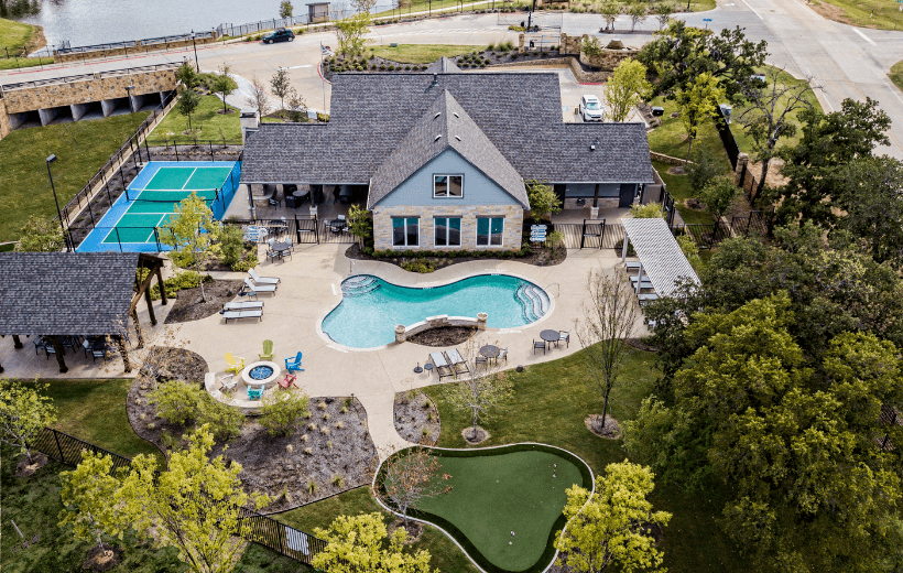 ladera texas active adult communities clubhouse, pool, and tennis court