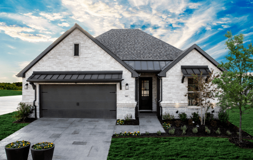 white and black house in ladera texas community